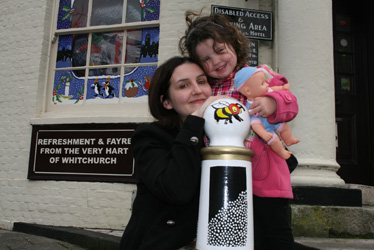 Julie Moss & daughter Liberty show off painted pub bollards at Whit Hart Whitchurch.jpg