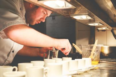 Chef Jamie Woods finishes off the Beef Tea Macchiato.jpg